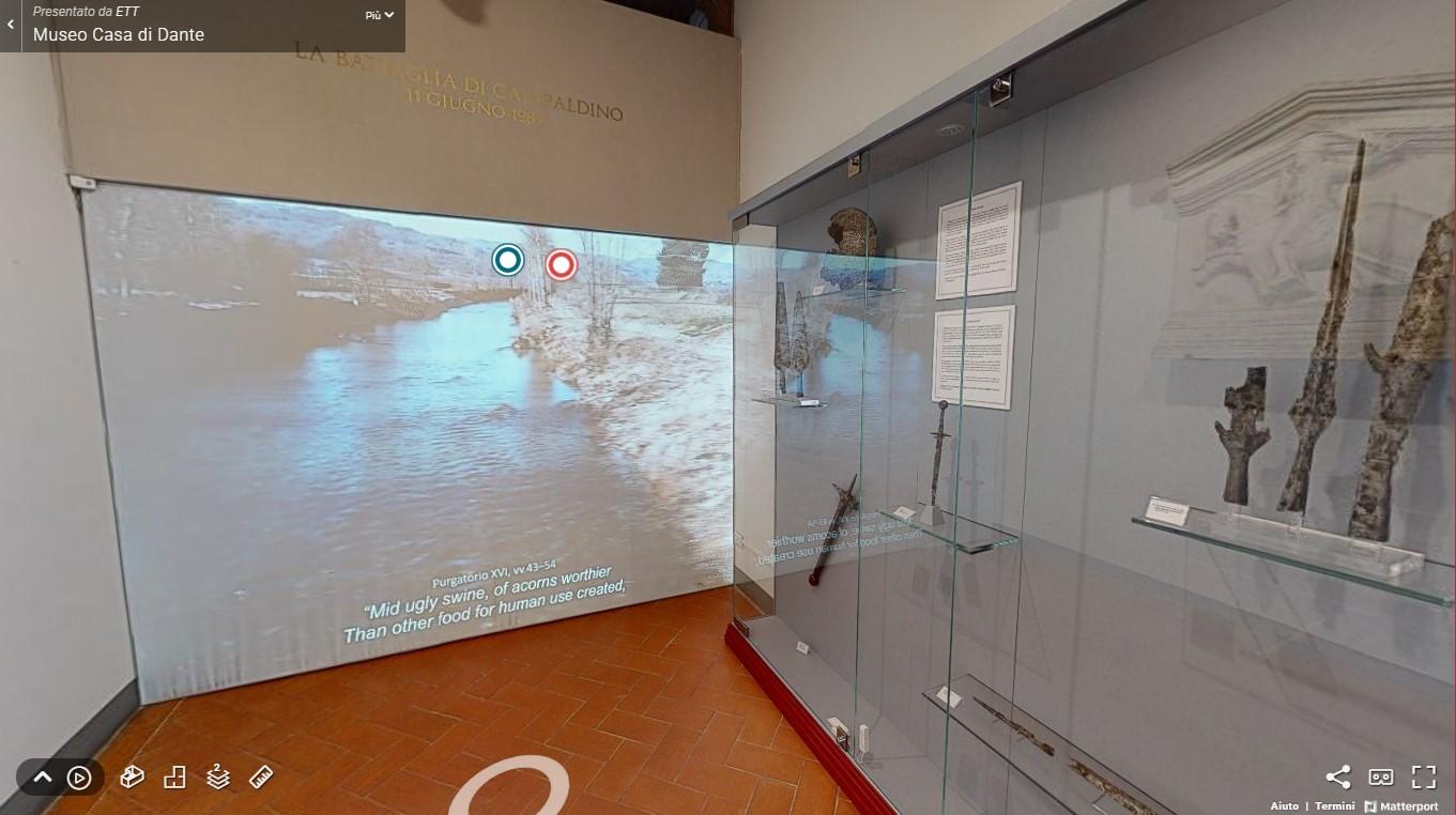 Fotogramma del virtual tour con proiezione su parete al Museo Casa di Dante